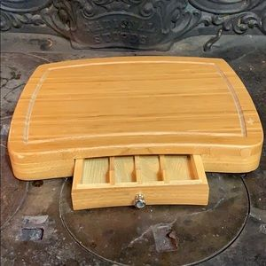 Gently used wooden cutting board with drawer.